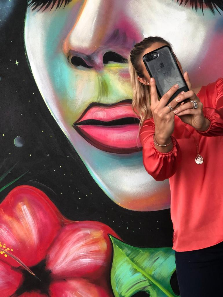 selfie-in-front-of-a-mural-in-cayman
